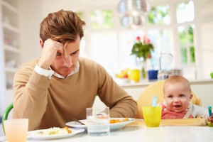 White British Father Feeling Depressed At Baby's Mealtime